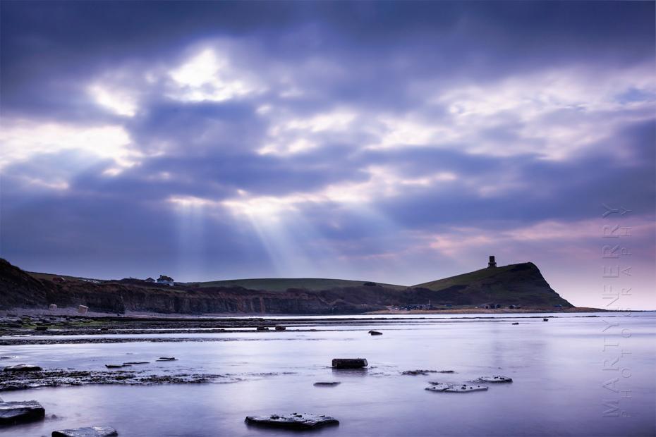 Sunbeams over the Dorset coast at Kimmeridge Bay