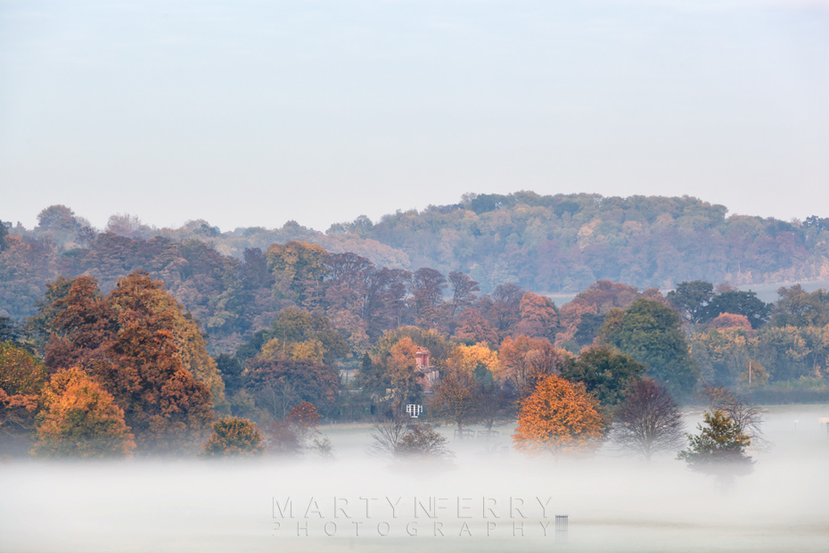 Mist surrounds an autumn landscape in Cambridgeshire