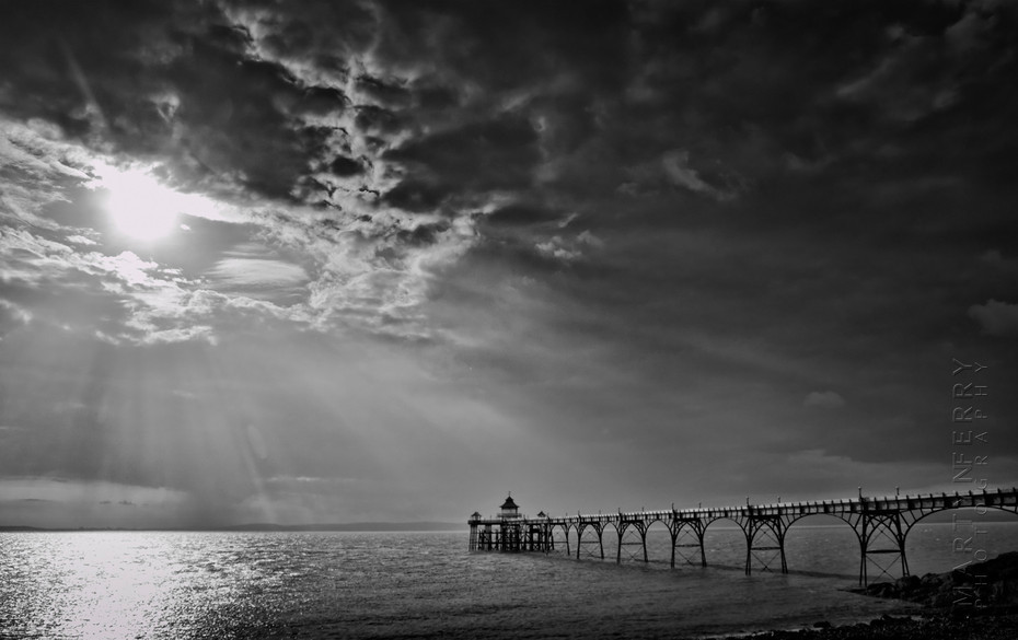 Stunning image of Clevedon pier in sunbeams