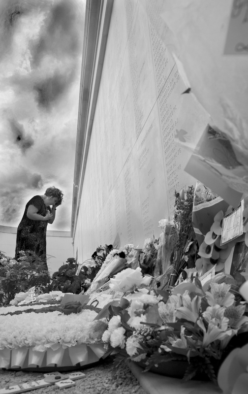 Viewing floral tributes bw - National Memorial Arboretum, Staffordshire, England