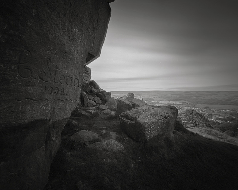 Black and White Picture of the rocks and Carvings on Cow and Calf Rocks Ilkley Moor
