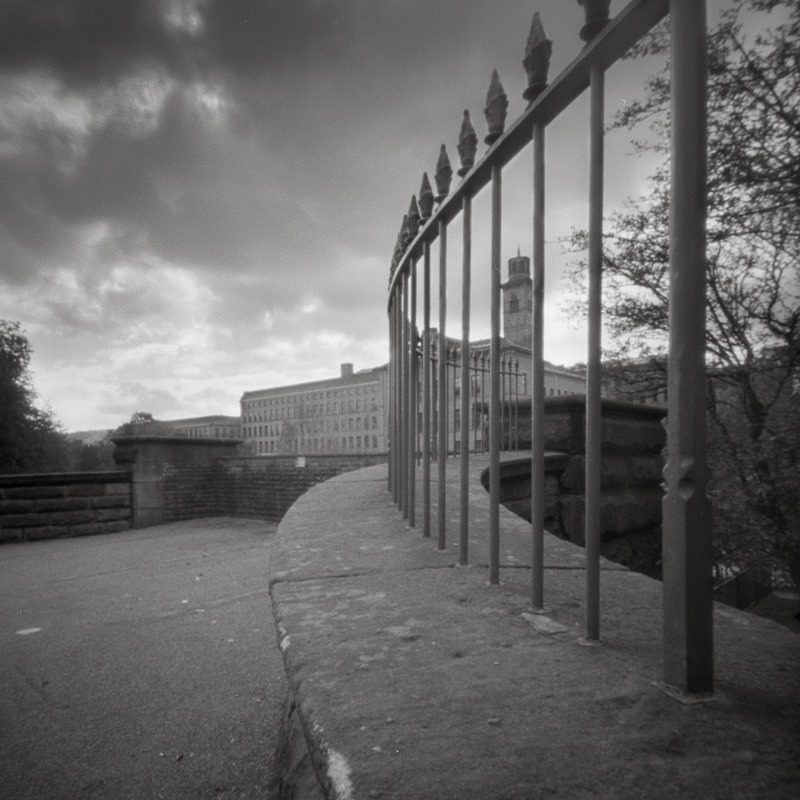 Salts Mill Through The Railings, Pinhole (square format) - Salts Mill and Leeds-Liverpool Canal