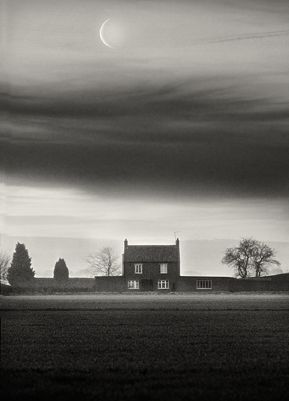 Black and White Farm house under crest moon