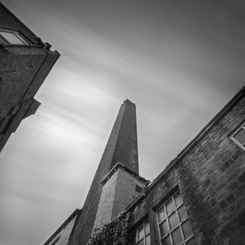 Chimney at Dockfield Mill (square format) - Salts Mill and Leeds-Liverpool Canal