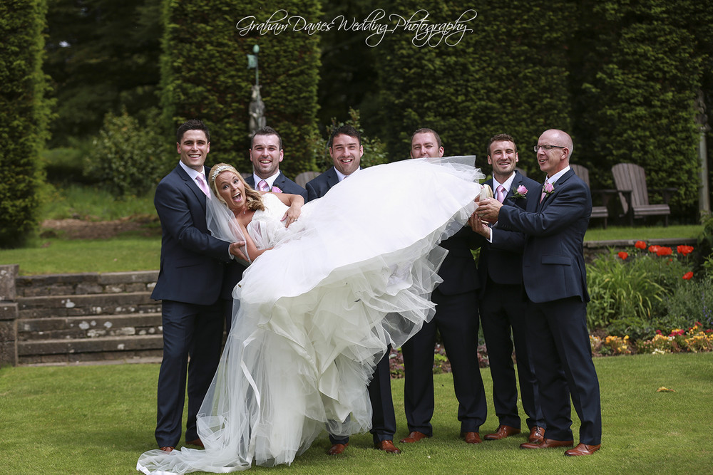 Miskin Manor Groom & ushers holding Bride - Wedding Photography at Miskin Manor