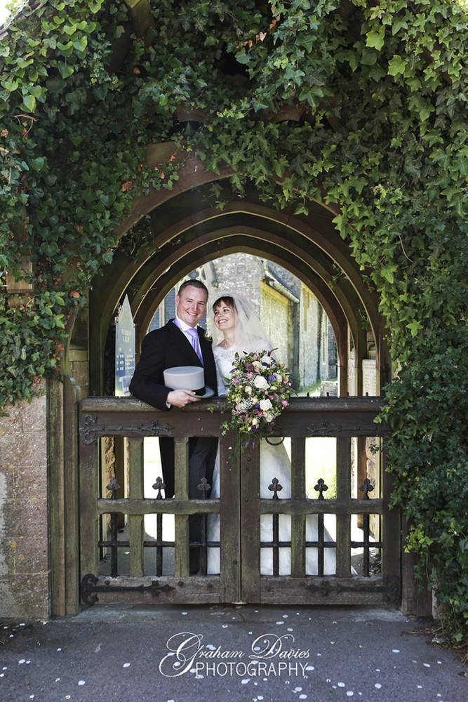 Bride & Groom at Gate at Wedding at St. Hilary - Wedding Photography at St. Hilary