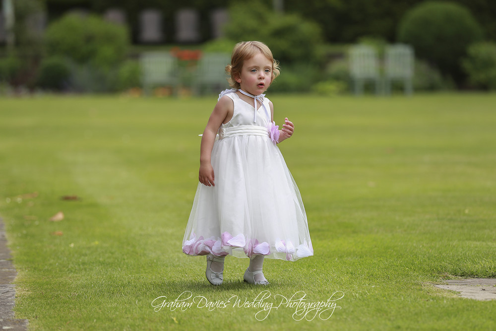 Miskin Manor flower girl playing - Wedding Photography at Miskin Manor