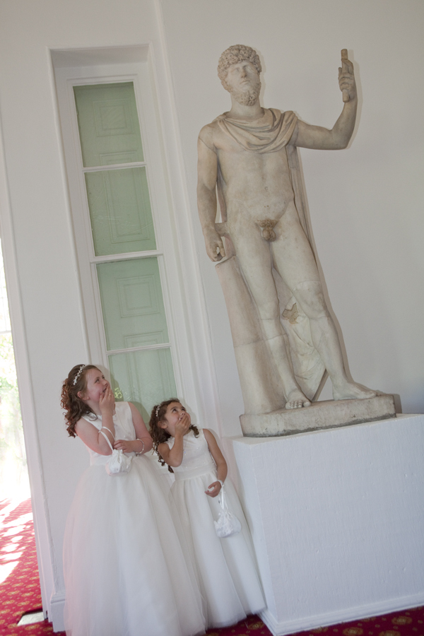 Two little brides maids giggling at statue in Margam Orangery - Wedding Photography at Margam Orangery