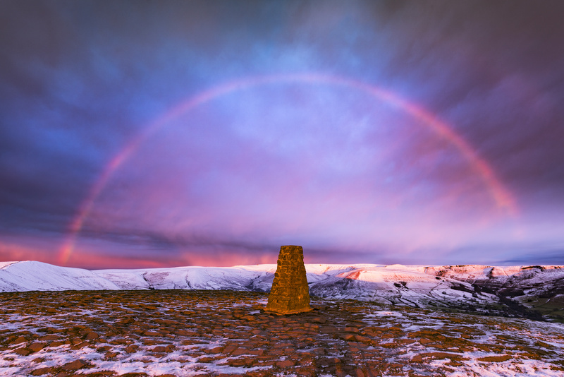 Winter rainbow over Mam Tor summit - Weather photography