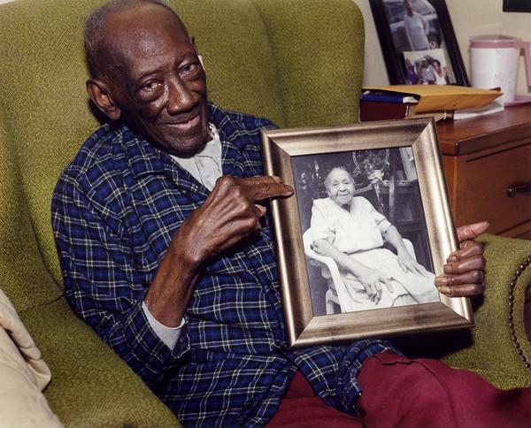 Reverend H.D. Dennis Holding Portrait of Margaret, Mississippi, 2011 - The True Gospel Preached Here