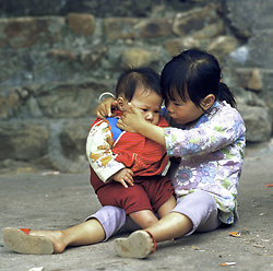 KM-71 Girl looking after her little brother, Kao Sai Chau - 1978