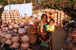 Pot seller with her baby - Jaipur Rajasthan