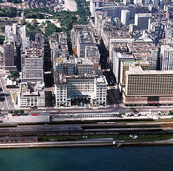 KM-203 Kowloon Railway station, YMCA & Peninsula hotel from air -1973