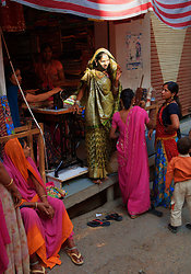 Deogarh, Rajasthan - bride being fitted for her wedding sari