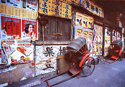 KM-93 Rickshaws and posters in Western - 1976